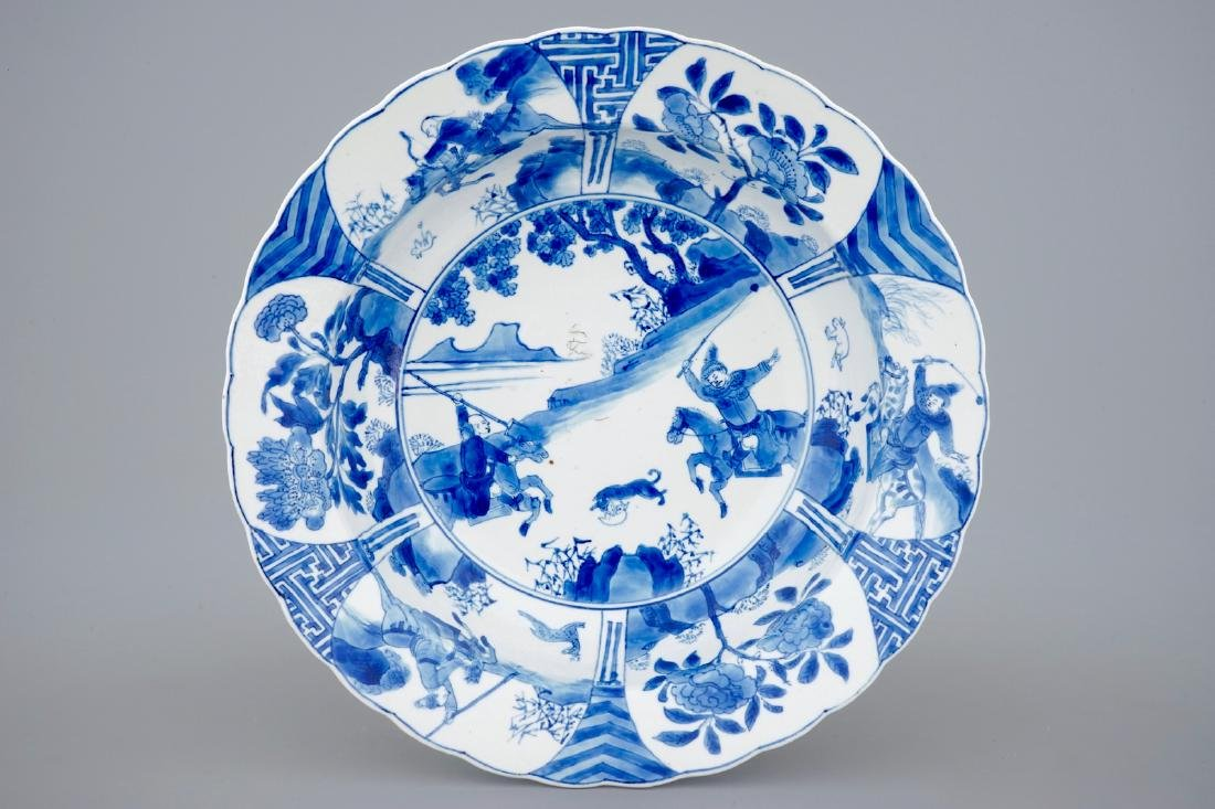 A deep Chinese blue and white plate with a battle scene