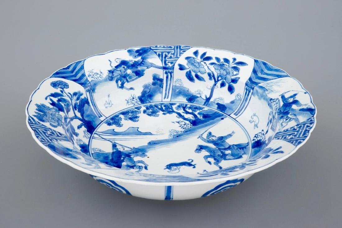 A deep Chinese blue and white plate with a battle scene - 2