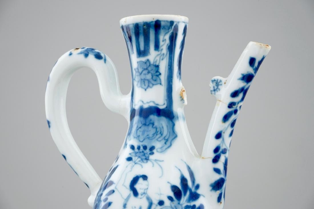 A small Chinese blue and white jug with a naked - 7