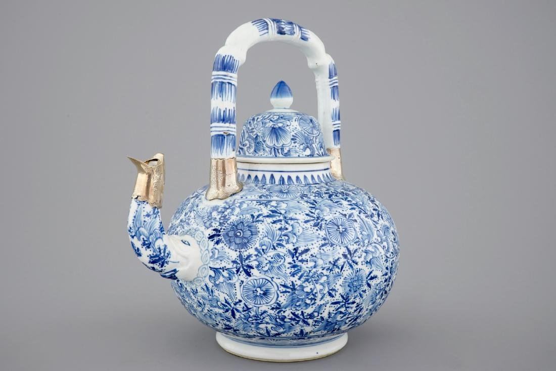 A large blue and white teapot with silver mount, Kangxi