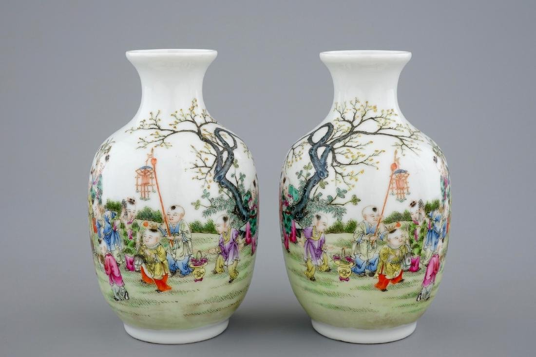 A pair of Chinese famille rose vases with playing boys,