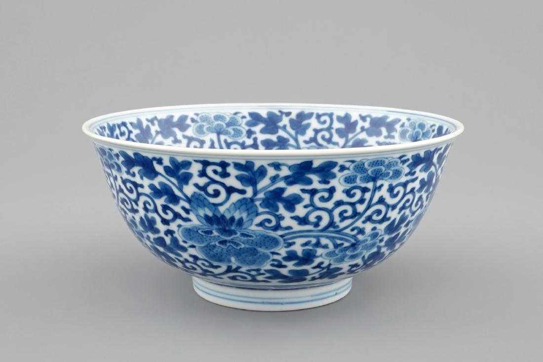 A Chinese blue and white peony scroll bowl, Qianlong