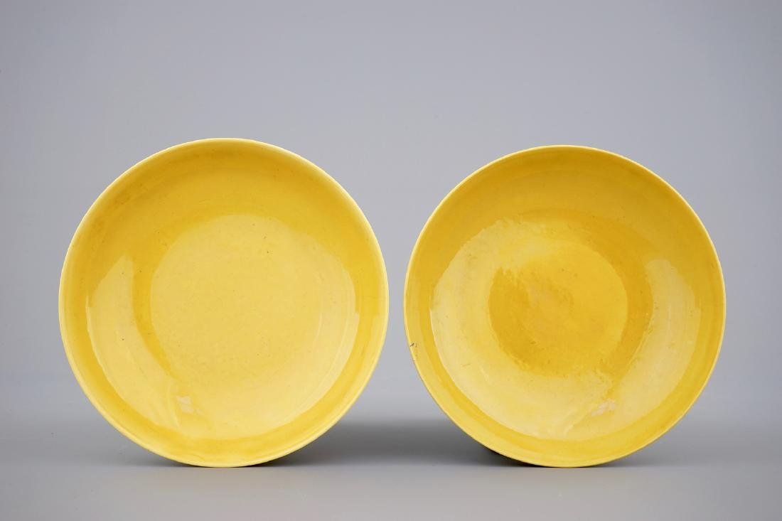 A pair of Chinese yellow glazed saucer dishes with