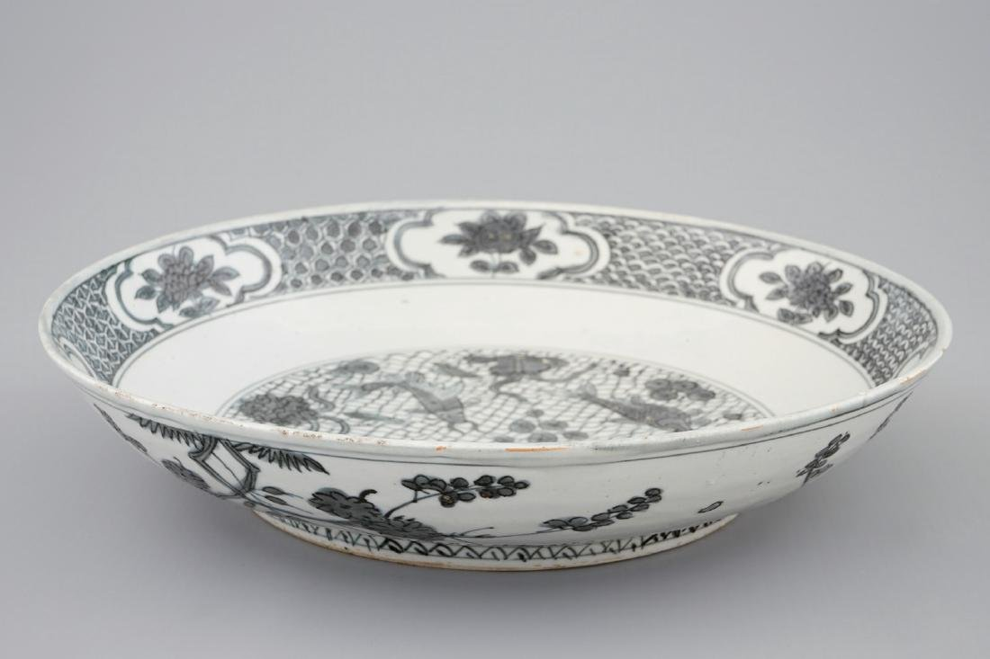 A Chinese Swatow dish with a blue-grey design of fish, - 3