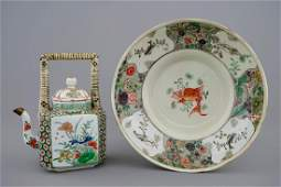 A Chinese famille verte teapot and a plate with fish
