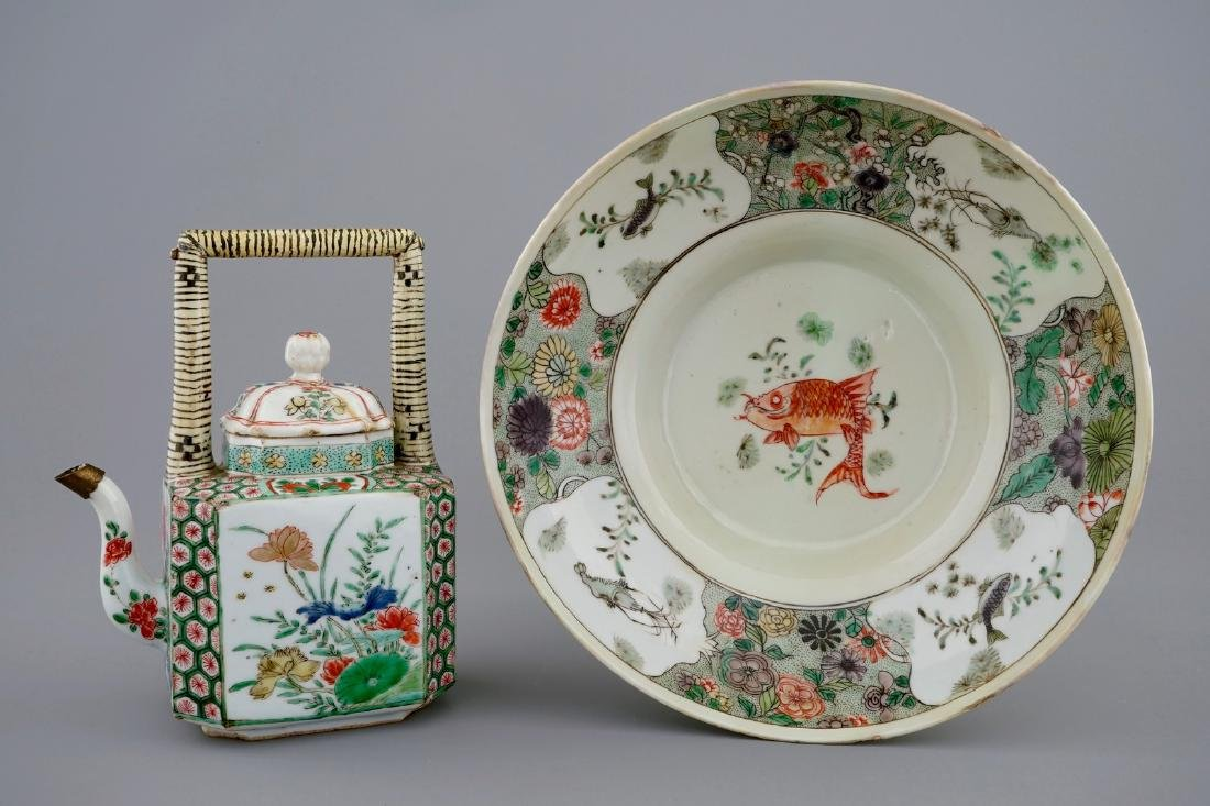 A Chinese famille verte teapot and a plate with fish,