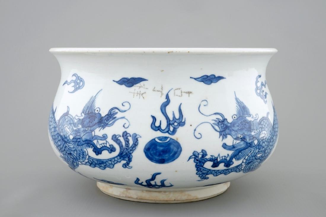 A blue and white Chinese censer with fighting dragons,