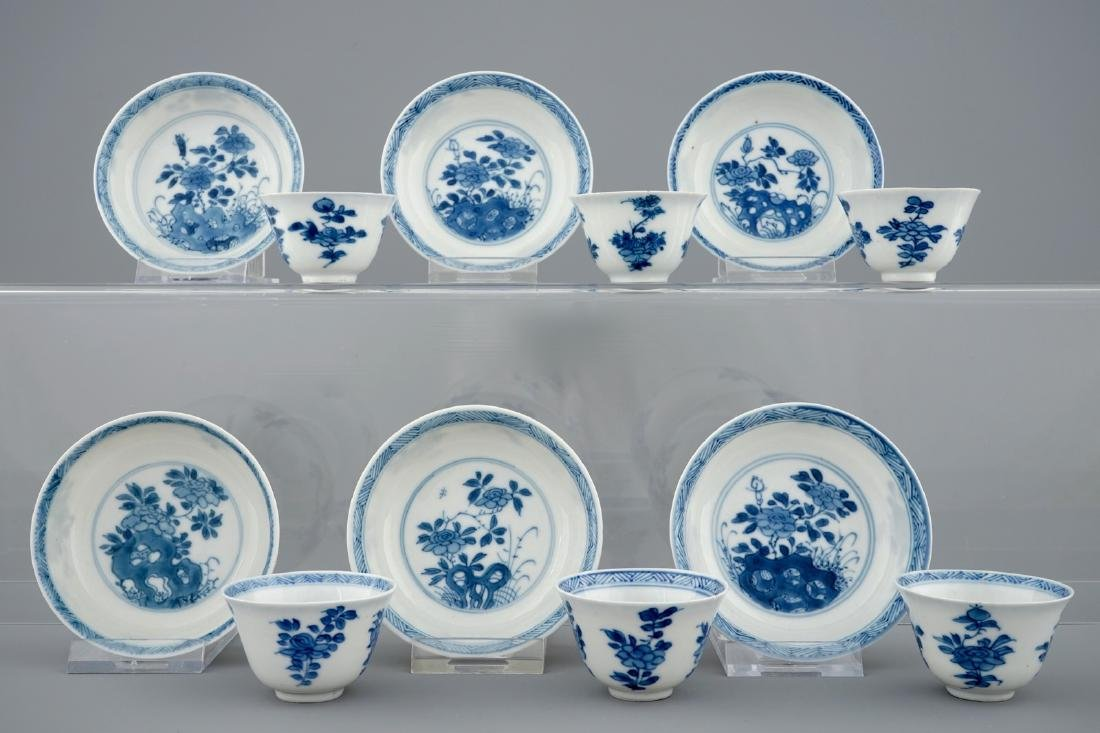 A set of six Chinese blue and white cups and saucers,