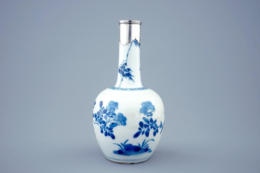 A Chinese blue and white bottle shaped vase with silver