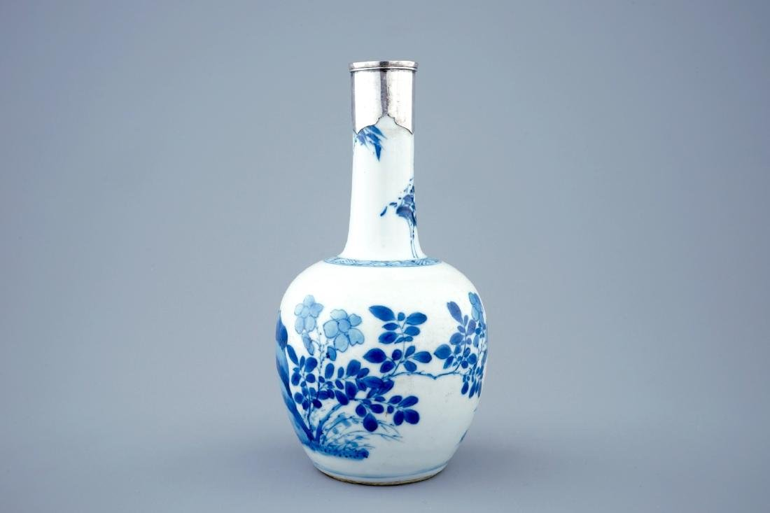 A Chinese blue and white bottle shaped vase with silver - 2