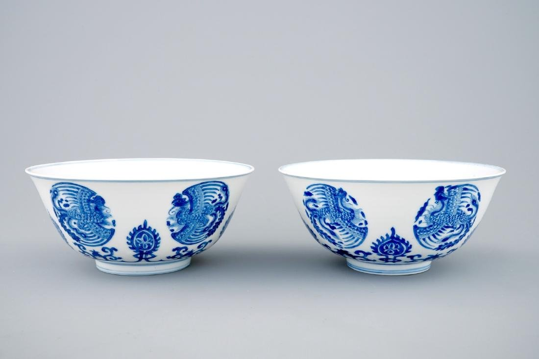 A pair of fine Chinese blue and white phoenix bowls,