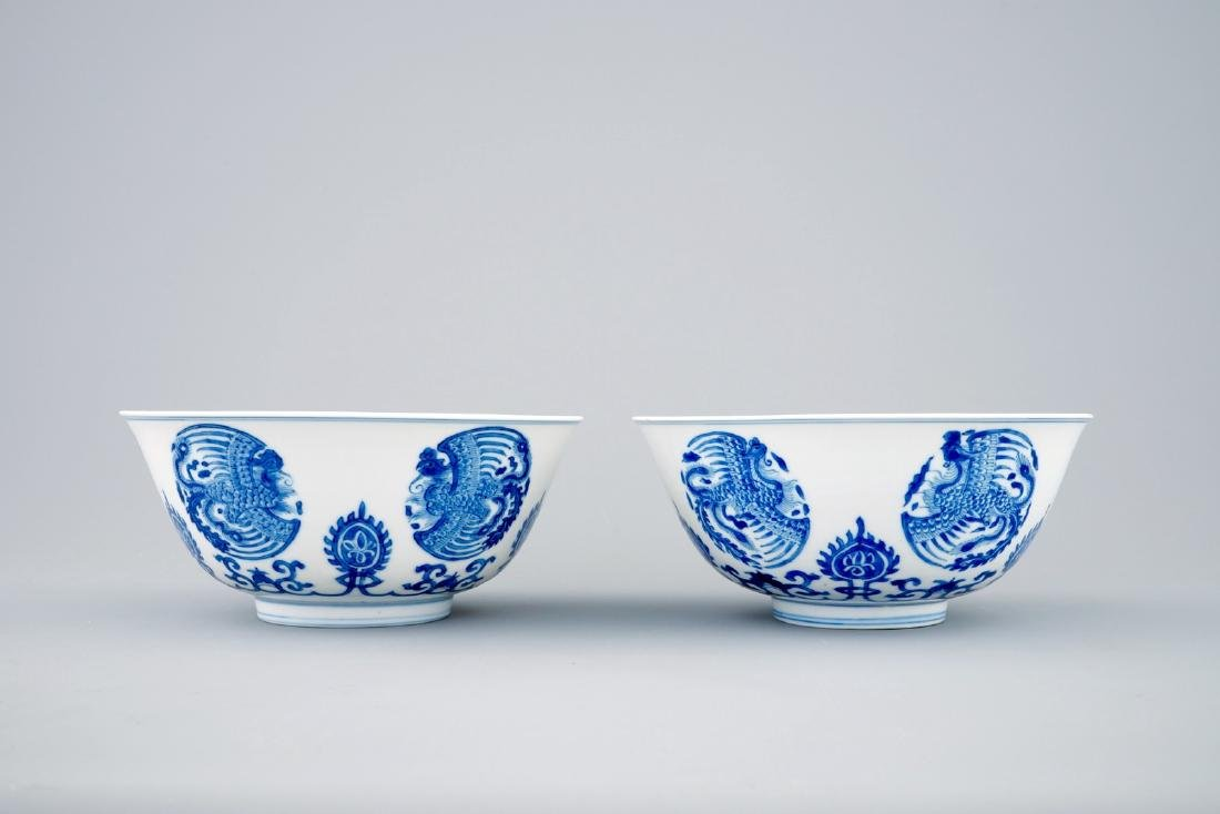 A pair of fine Chinese blue and white phoenix bowls, - 2