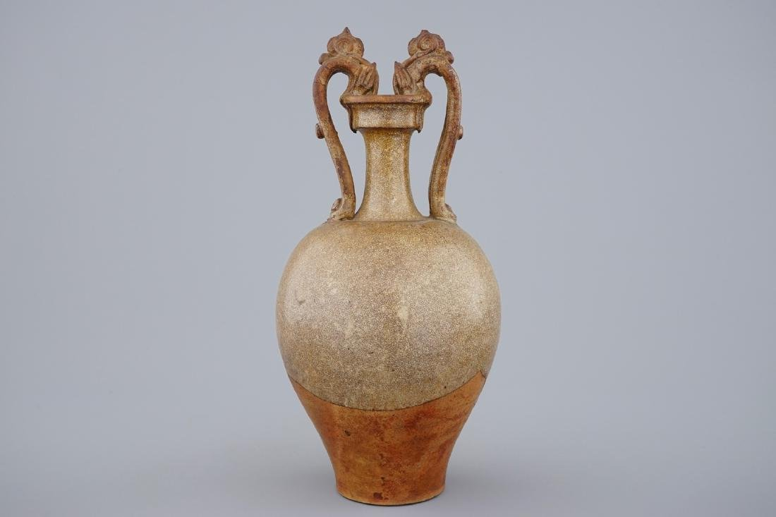 A Chinese stoneware amphora vase with dragon handles,