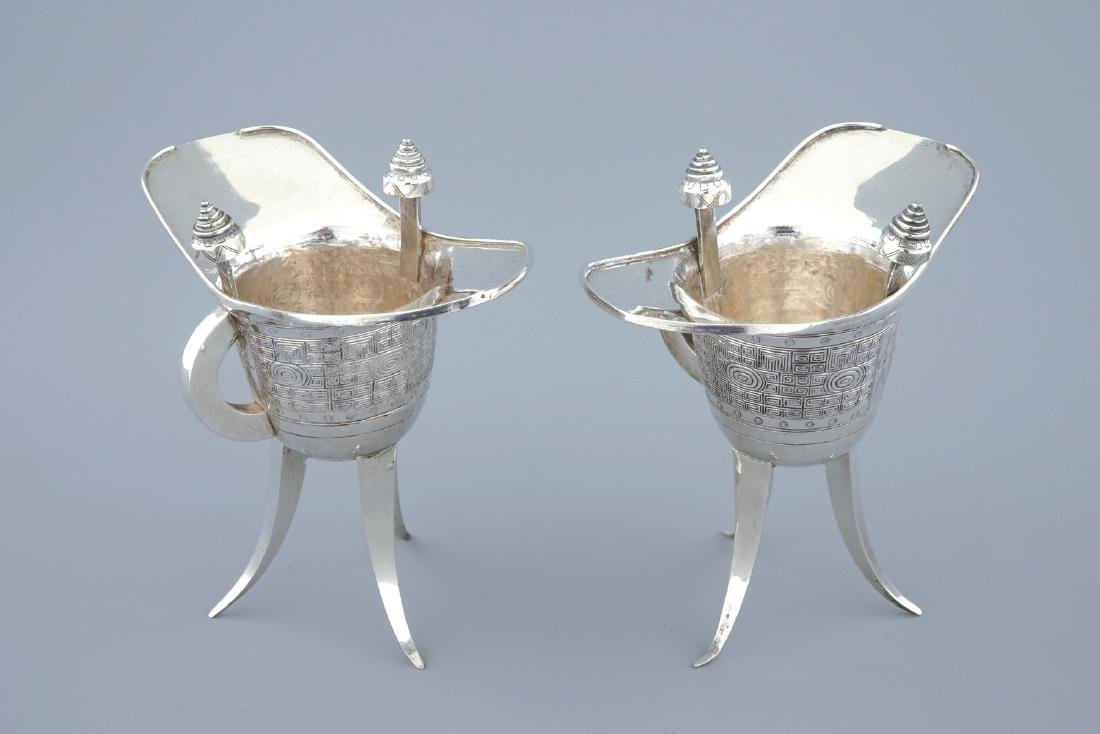 "A pair of Chinese silver archaic ""Jue"" wine cups marked"