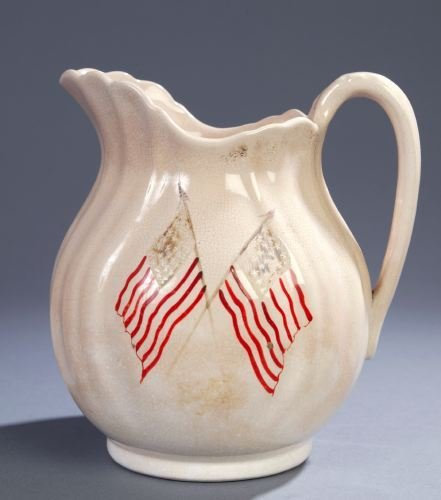 5: AN IRONSTONE PITCHER The side painted with two cros
