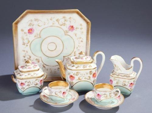 10: A MINIATURE CHINA TEA SET Comprising a teapot, cov