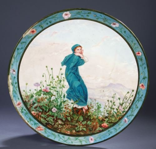 12: A CONTINENTAL PORCELAIN CHARGER Circular, painted