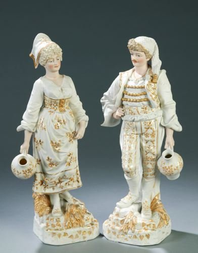 19: A PAIR OF BISQUE PORCELAIN FIGURINES 20th C. Mode