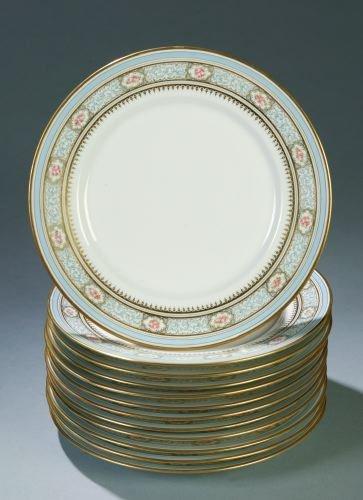 23: A SET OF TWELVE LIMOGES PORCELAIN DINNER PLATES Wm