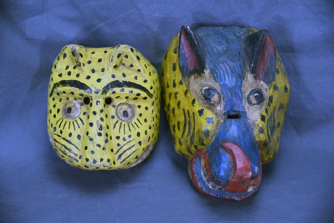 2 Hand Carved and Painted Wooden Face Masks