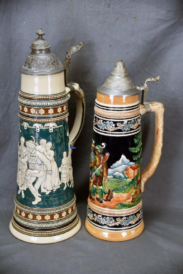 2 Tall German Pottery Relief Steins Pewter Lids