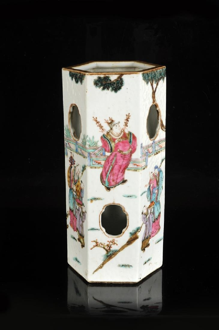 A polychrome porcelain hatstand with a decor of