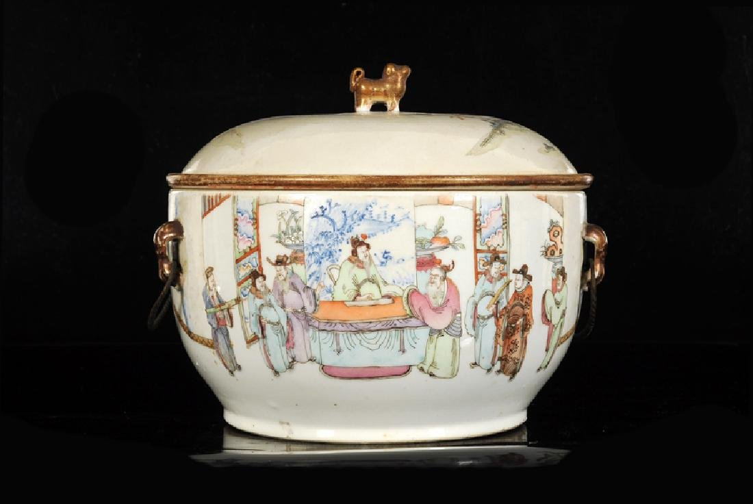 A polychrome porcelain tureen with cover and inner bowl