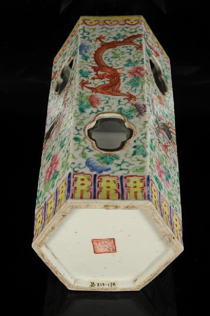 A polychrome porcelain hatstand with a decor of dragons