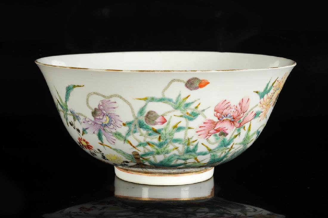 A polychrome porcelain bowl with a decor of flowers in