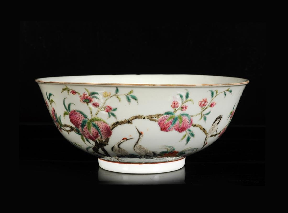 A polychrome porcelain bowl with a decor of peaches and