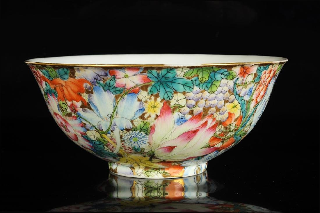 A polychrome porcelain bowl with a mille fleurs decor.