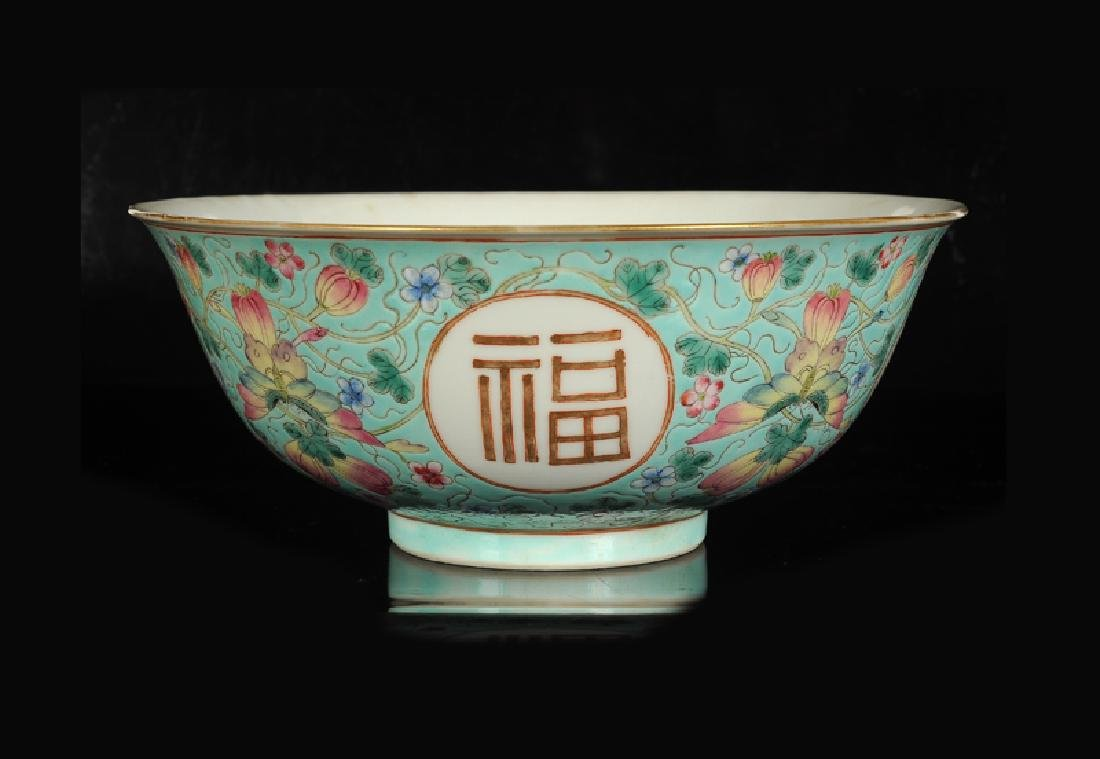 A polychrome porcelain bowl with decor of four