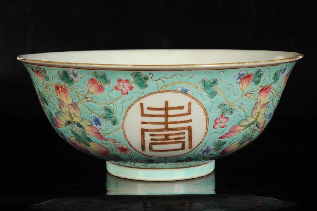 A polychrome porcelain bowl with decor of four - 2