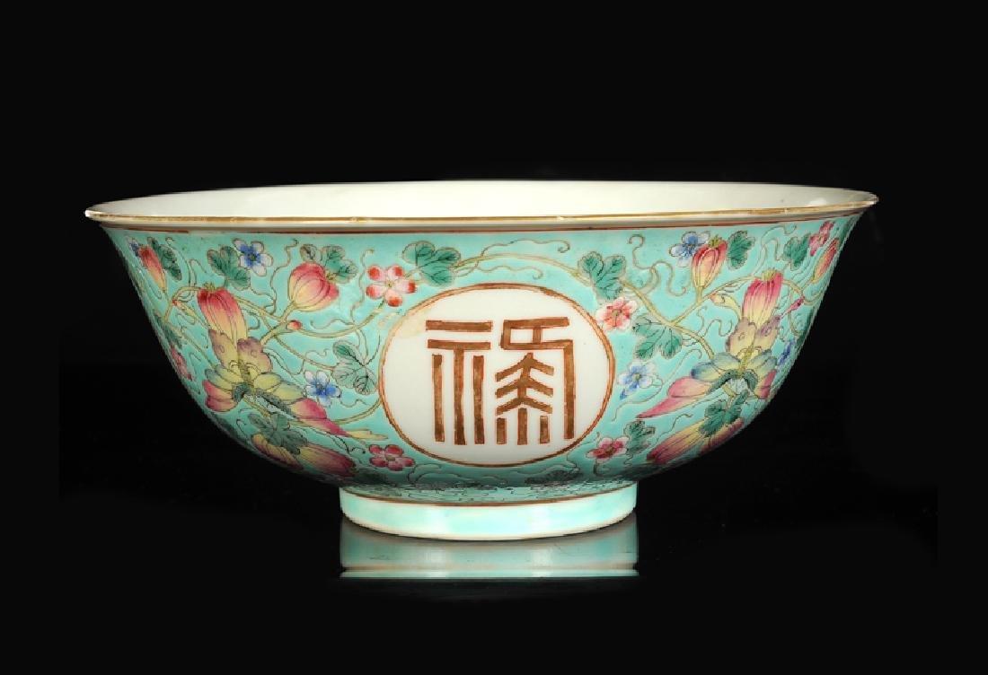 A polychrome porcelain bowl with decor of four - 3