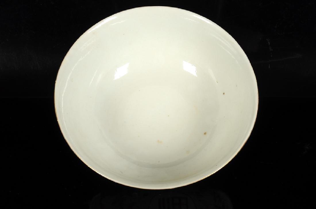 A polychrome porcelain bowl with decor of four - 4
