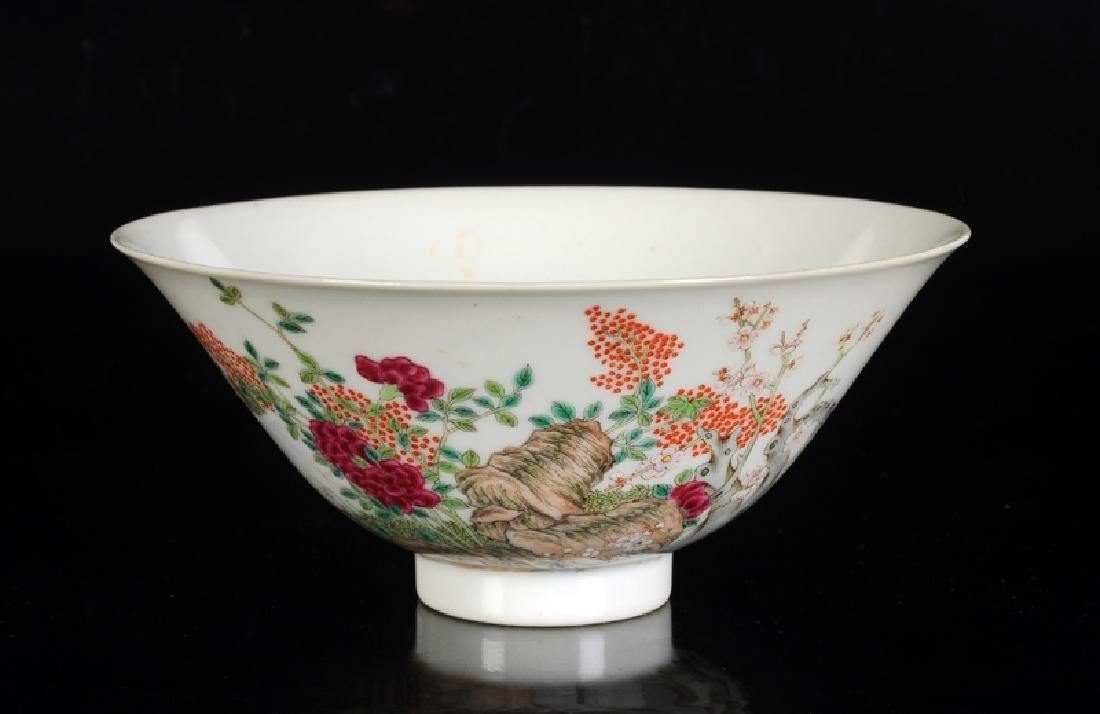 A polychrome porcelain bowl with a decor of three goats