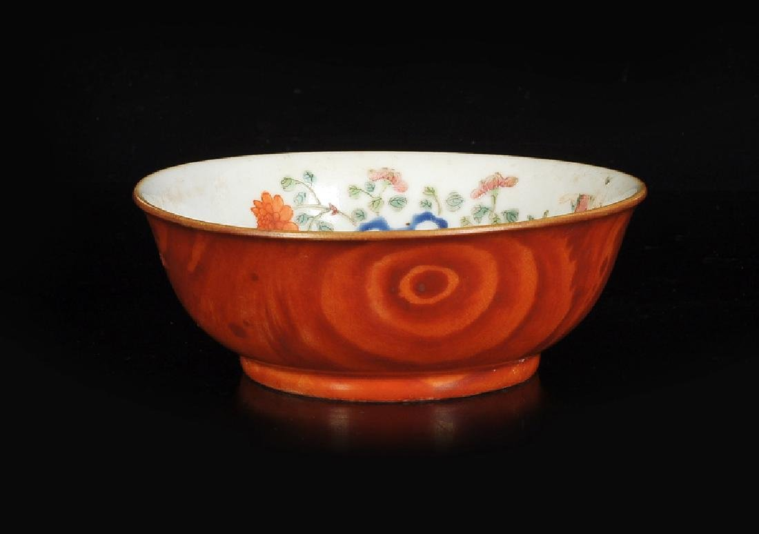 A small polychrome porcelain bowl with a decor of a