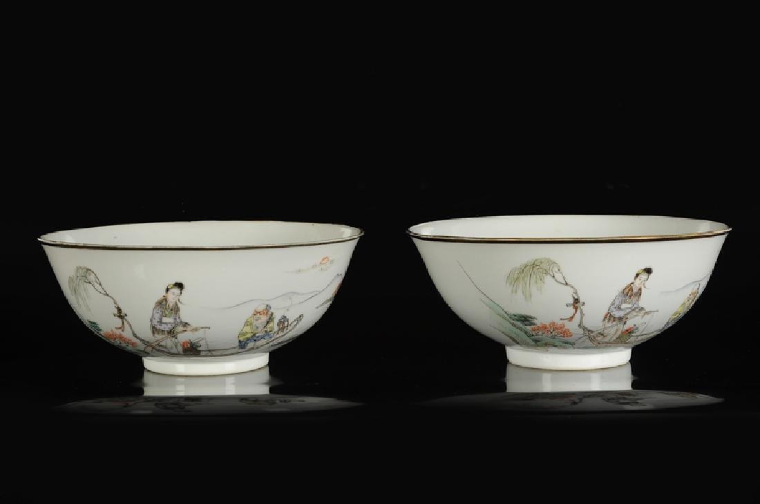 A pair of polychrome porcelain bowls with a decor of