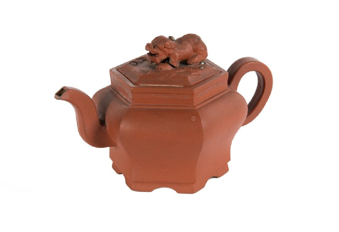 A hexagonal Yixing teapot, knob in the shape of a lion.