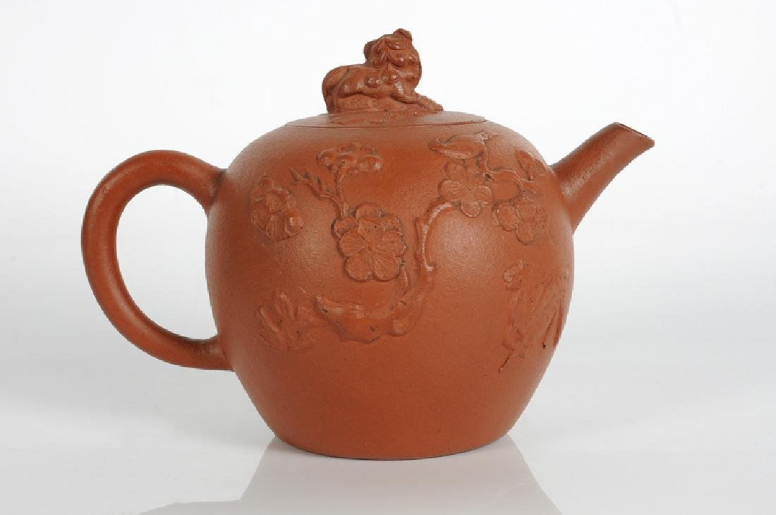A Yixing terracotta teapot with peach skin with an
