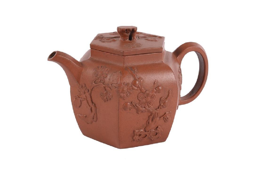 A hexagonal Yixing terracotta teapot with a decor in