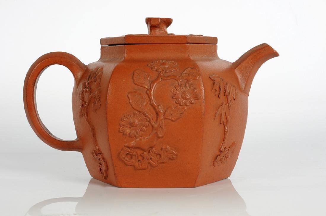 A hexagonal Yixing terracotta teapot with a decor in - 3