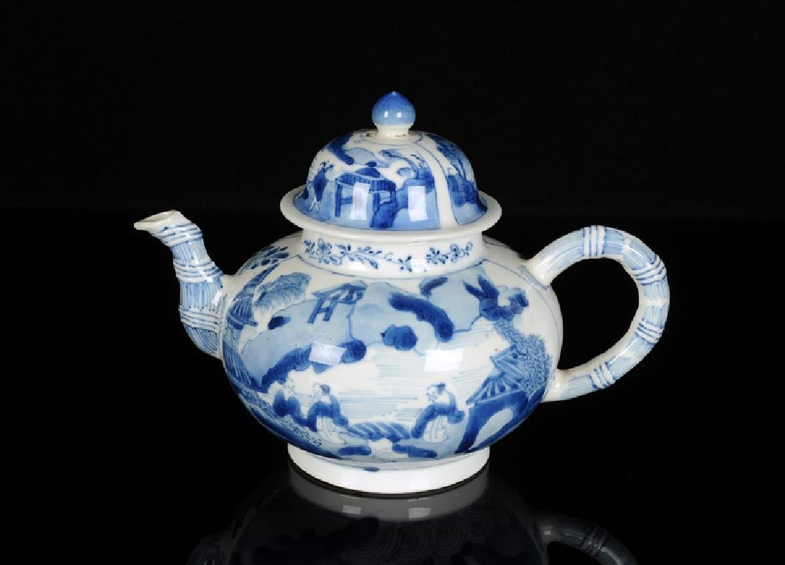A blue and white porcelain teapot with bamboo shaped