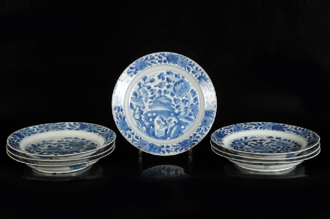 Seven blue and white porcelain dishes with floral