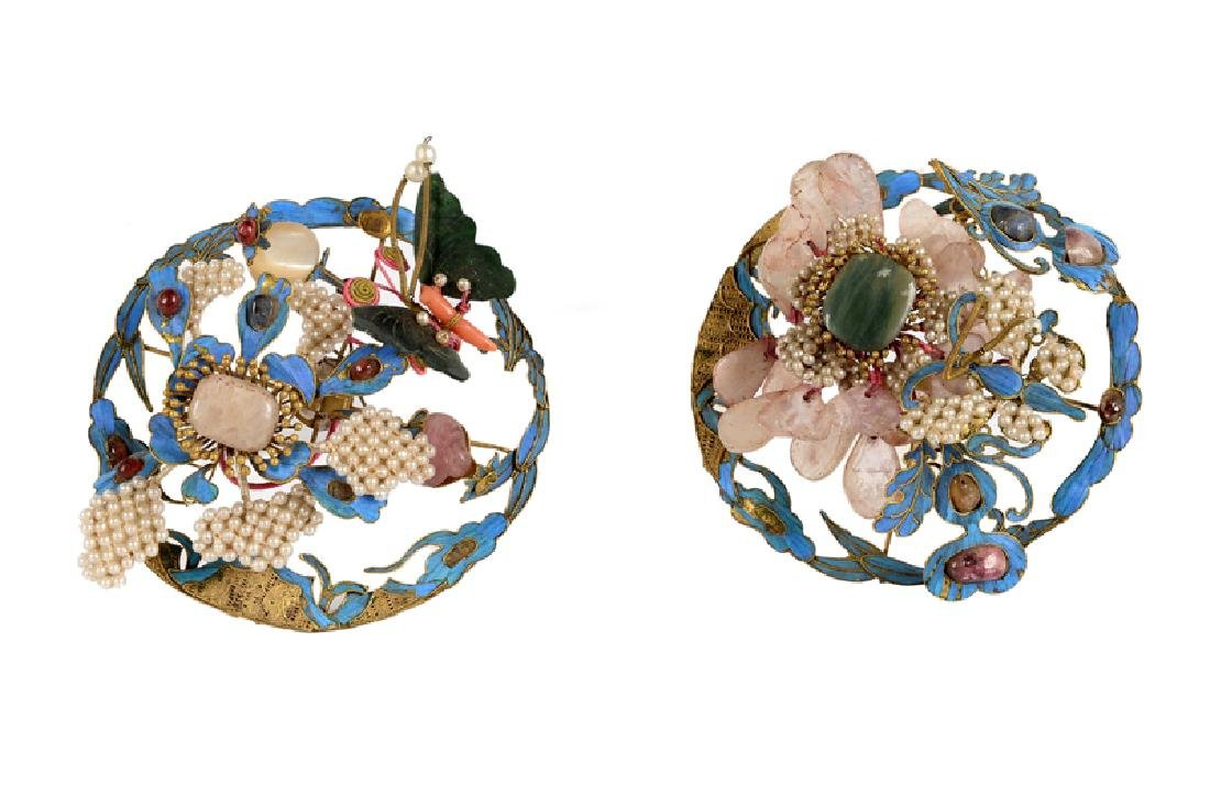Two hairpins, decorated with a butterfly and flower,