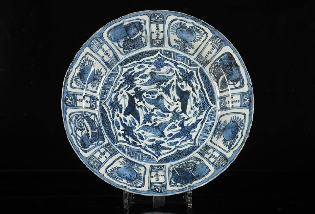 A blue and white porcelain dish, decorated with cranes