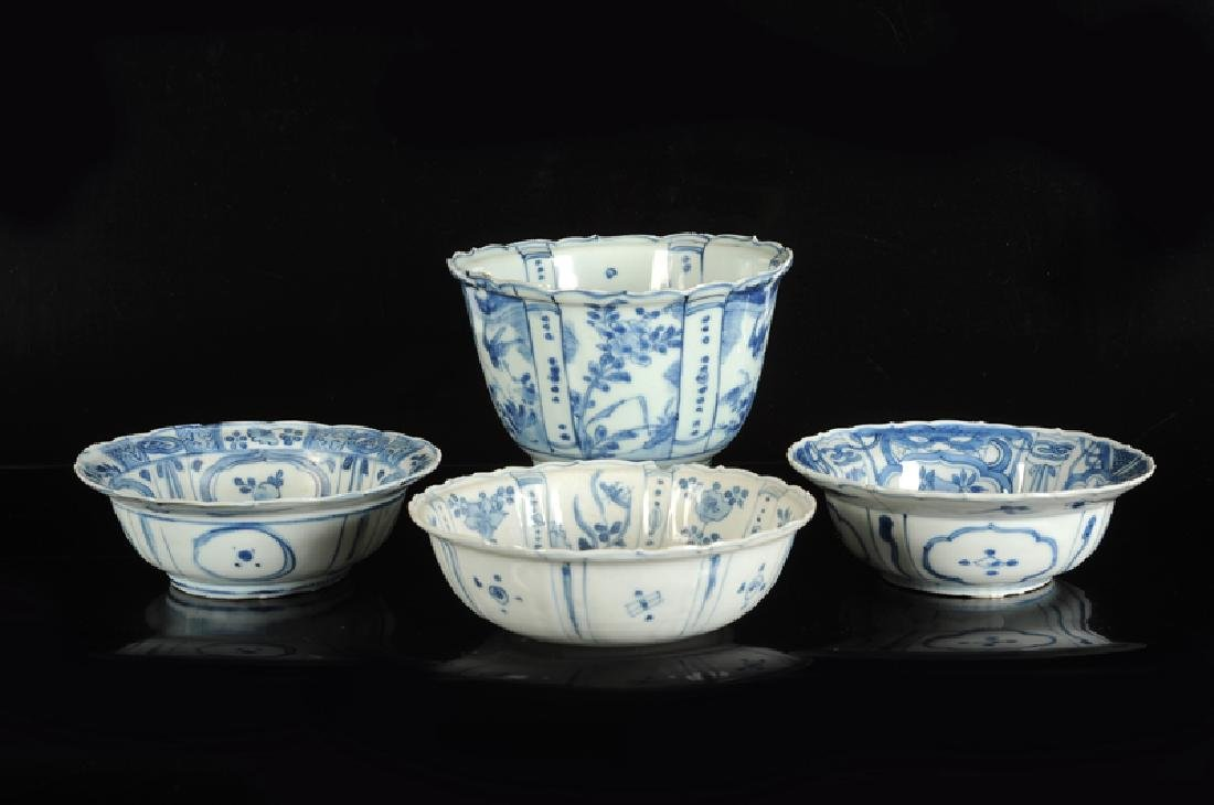 A blue and white porcelain deep bowl with a panel decor