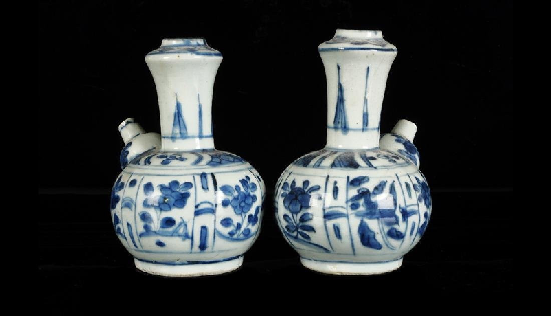 A pair of blue and white porcelain gendi's, decorated