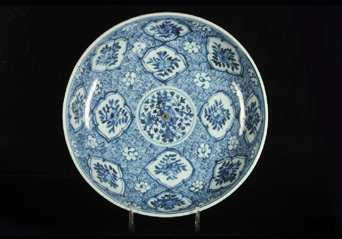 A blue and white porcelain charger, decorated with