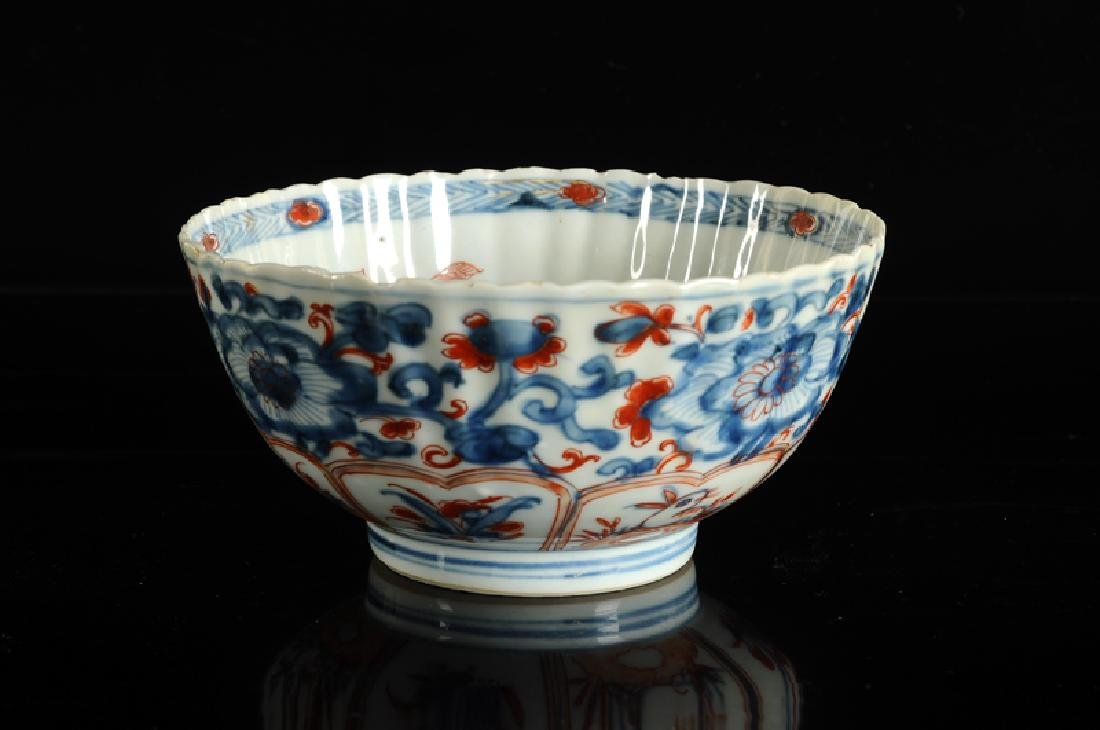 A lobbed Imari porcelain bowl, decorated with panels